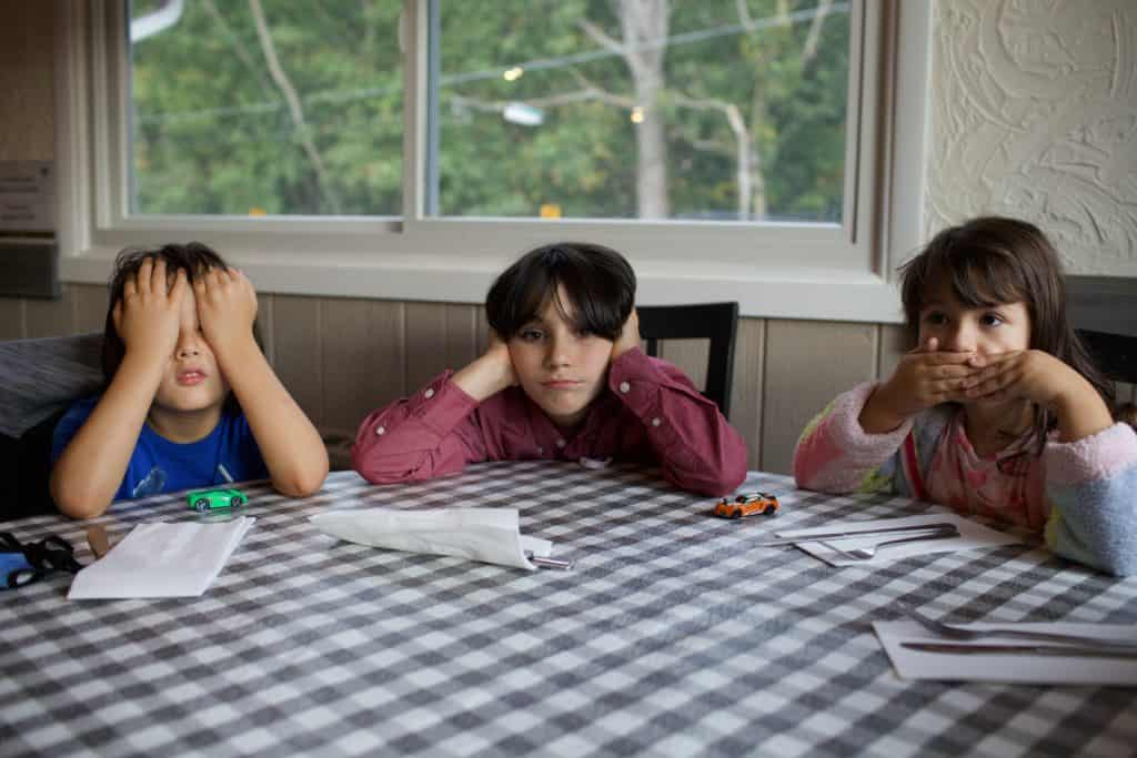 mental health activities for primary school - 3 children waiting at a dinner  table