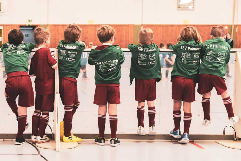 mental health activities for primary school - 7 school boys wearing sports uniforms and waiting